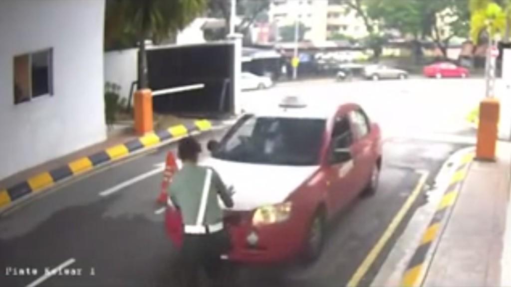 taxi hit guard